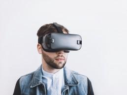 Bearded man wearing virtual reality headset