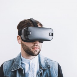 Bearded man wearing virtual reality headset