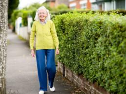 Older resident walking down street in Belfast neighbourhood